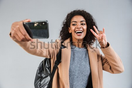Happy pregnant woman holding ultrasound scans Stock photo © deandrobot
