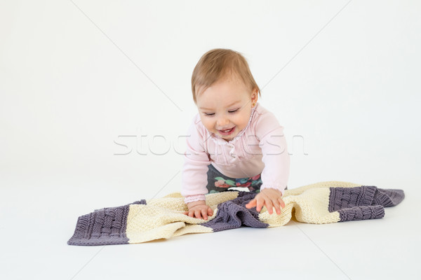 Happy girl sitting on floor with plaid isolated Stock photo © deandrobot