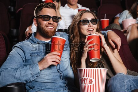 Concentrated friends loving couple sitting in cinema Stock photo © deandrobot