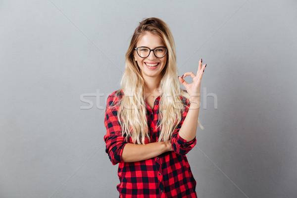 Heureux jeunes femme blonde ok geste Photo stock © deandrobot