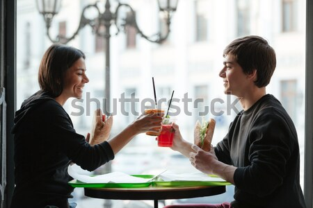 Brother and sister sitting in cafe with burgers Stock photo © deandrobot