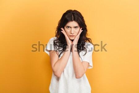 Surpreendido jovem morena mulher amarelo vestir Foto stock © deandrobot
