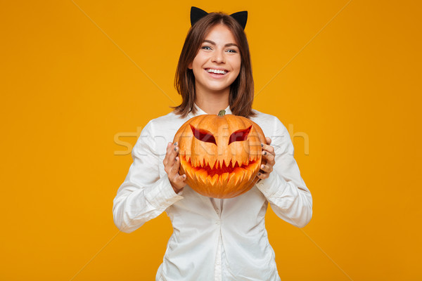 Cheerful young woman dressed in crazy cat halloween costume Stock photo © deandrobot