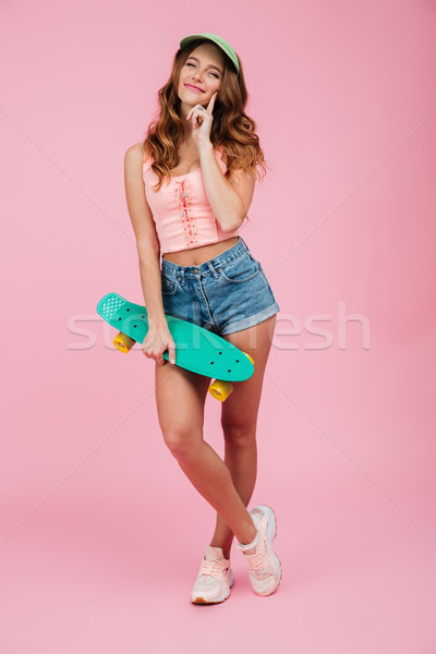 Full length portrait of a beautiful woman in summer clothes Stock photo © deandrobot