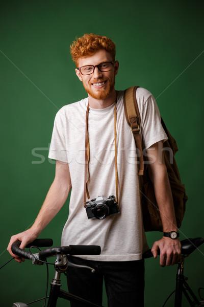 Jovem feliz barbudo homem mochila retro Foto stock © deandrobot