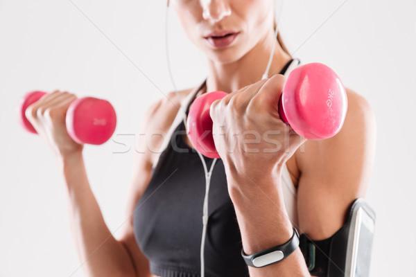 Portret młodych kobieta fitness hantle odizolowany Zdjęcia stock © deandrobot
