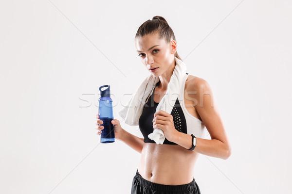 Fáradt izzadt fitnessz nő törölköző nyak tart Stock fotó © deandrobot