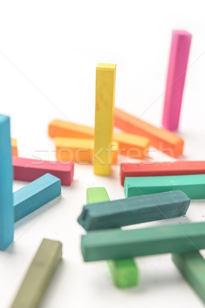 Cropped of group colored pastel chalks in a chaotic manner Stock photo © deandrobot