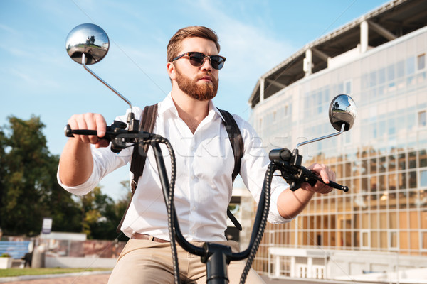 Carefree bearded man in sunglasses with backpack Stock photo © deandrobot
