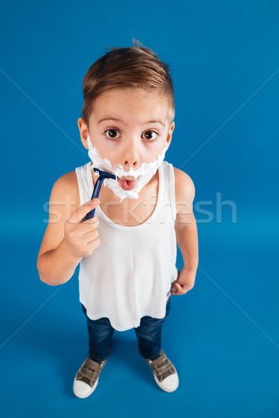 Függőleges felső kilátás kép fiatal srác arc Stock fotó © deandrobot