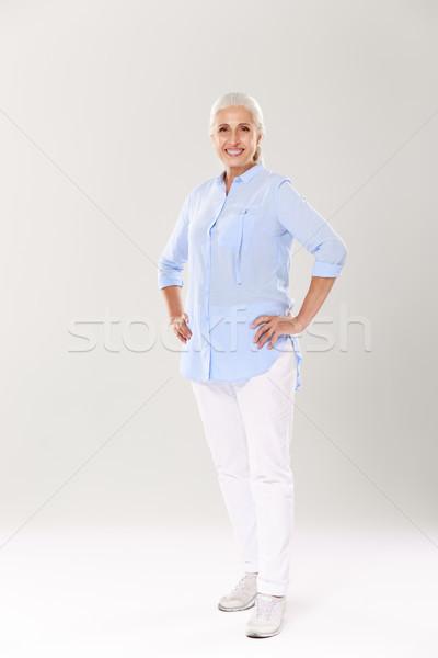 Portret wesoły starsza kobieta niebieski shirt biały Zdjęcia stock © deandrobot