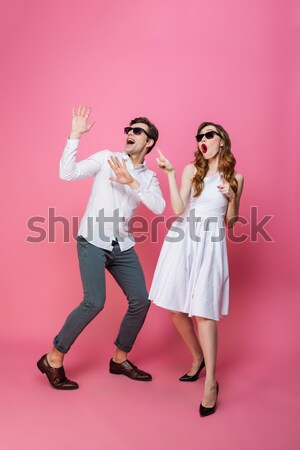 Full length image of two happy women rejoice with money Stock photo © deandrobot