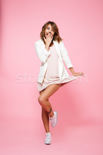 Full length portrait of a lovely embarrassed girl Stock photo © deandrobot