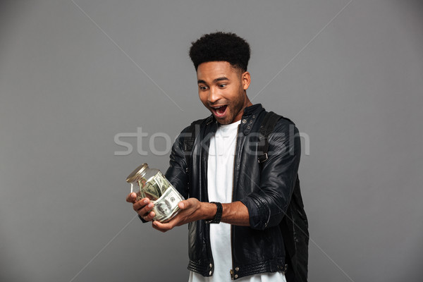 Portrait of a happy afro american man in leather jacket Stock photo © deandrobot