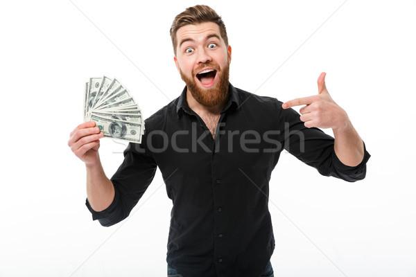 Elégedett szakállas üzletember póló tart pénz Stock fotó © deandrobot