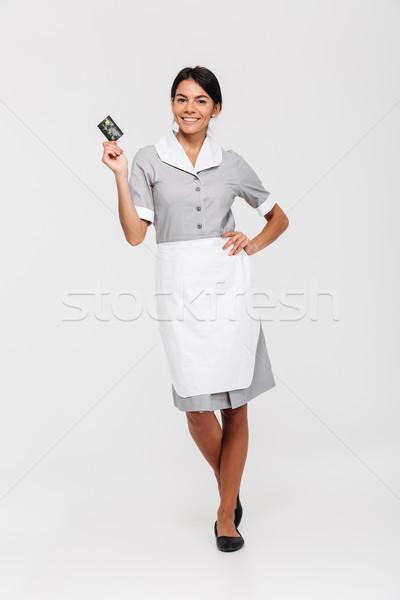 Foto mooie brunette huishoudster permanente Stockfoto © deandrobot