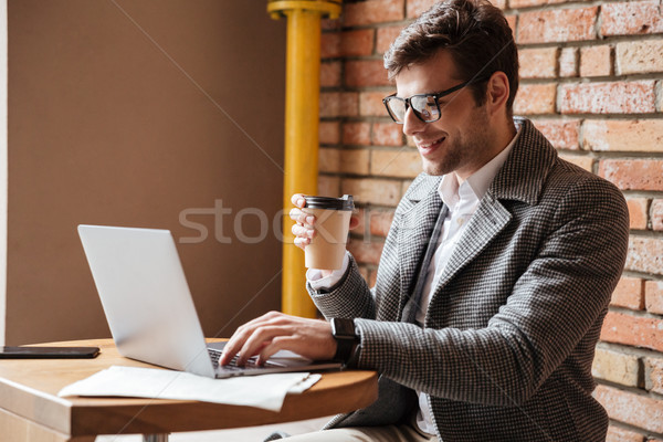 Side view of Smiling business man in eyeglasses Stock photo © deandrobot