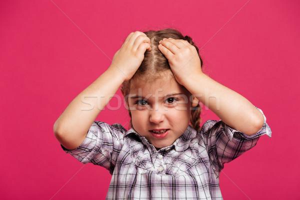 Confondre cute petite fille enfant photos permanent Photo stock © deandrobot