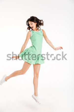 Full length portrait of a cheerful girl in dress posing Stock photo © deandrobot