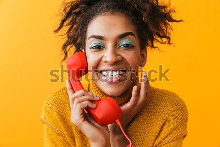Gorgeous afro american woman in colorful adornment embarrassing  Stock photo © deandrobot