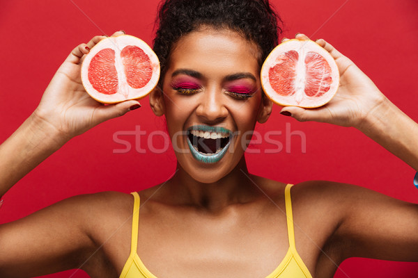 Food fashion photo of delighted afro american woman having fun h Stock photo © deandrobot
