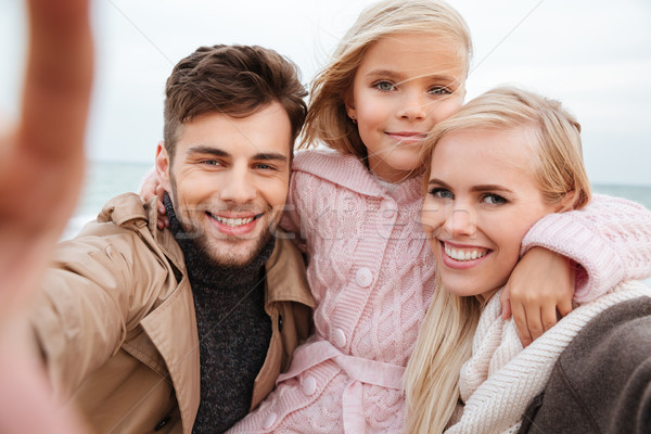 Portrait of a happy family with a little daughter Stock photo © deandrobot
