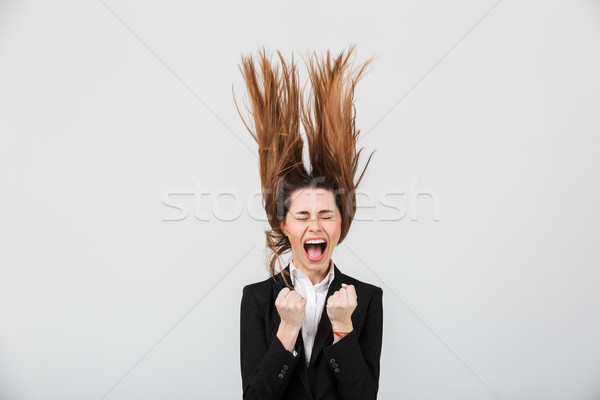 Portrait of a mad businesswoman dressed in suit Stock photo © deandrobot