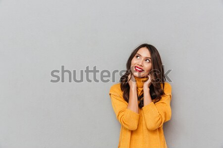 Zamyślony kobieta sweter podbródek Zdjęcia stock © deandrobot