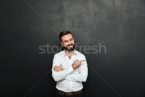 Smiling man in white shirt posing on camera with broad smile, po Stock photo © deandrobot