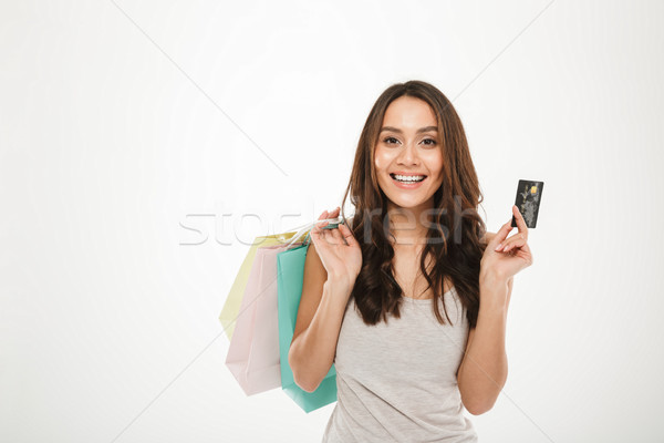 Portrait of rich and trendy woman with buying purchases and payi Stock photo © deandrobot
