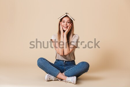 Full-length picture of concentrated woman in casual clothes medi Stock photo © deandrobot