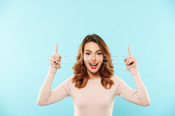肖像 年輕的女孩 毛線衣 指向 二 商業照片 © deandrobot
