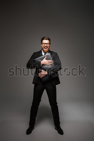 Full length portrait of an excited young businessman Stock photo © deandrobot
