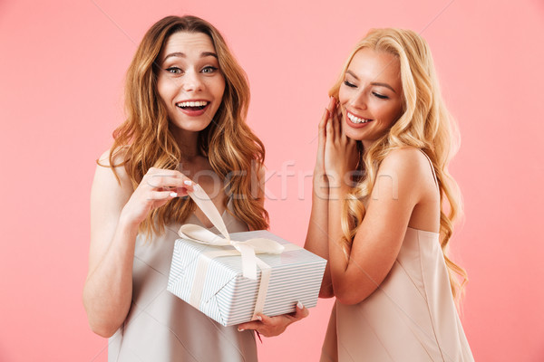 Surprised happy brunette woman in pajamas standing with her friend Stock photo © deandrobot