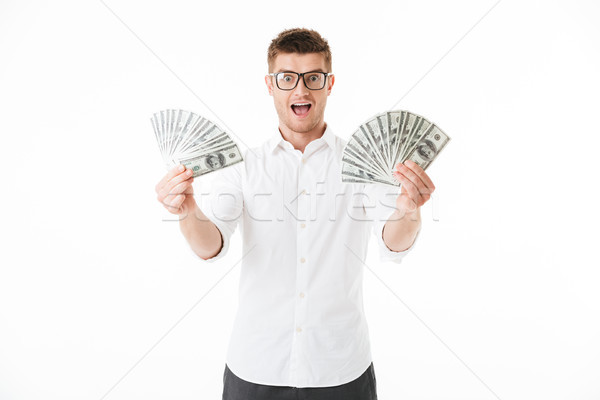 Portrait of an excited young man in eyeglasses Stock photo © deandrobot