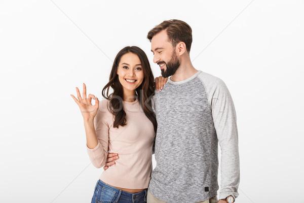 Boldog fiatal szerető pár gyártmány oké Stock fotó © deandrobot