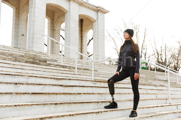 Photo of atlethic disabled woman in sportswear with prosthetic l Stock photo © deandrobot