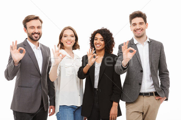 Group of happy multiracial business people showing ok Stock photo © deandrobot