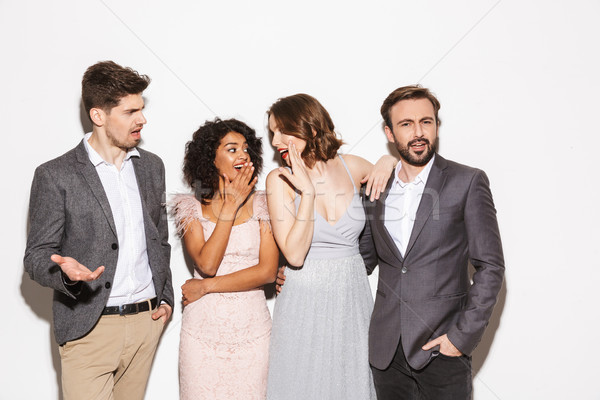 Group of well dressed multiracial people Stock photo © deandrobot