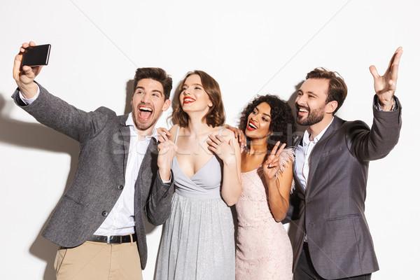 Csoport boldog jólöltözött emberek elvesz mobiltelefon Stock fotó © deandrobot