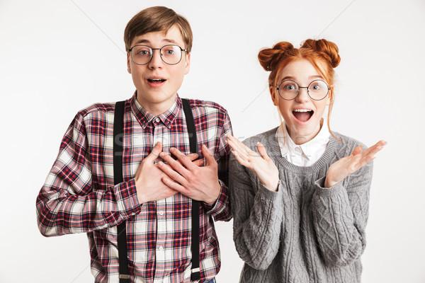 Excité couple école regarder caméra isolé Photo stock © deandrobot