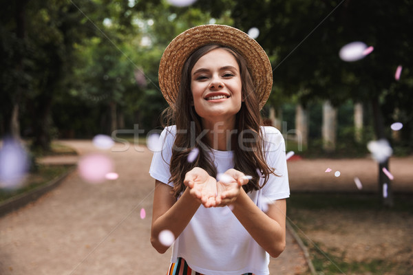 Happy young girl catching confetti Stock photo © deandrobot