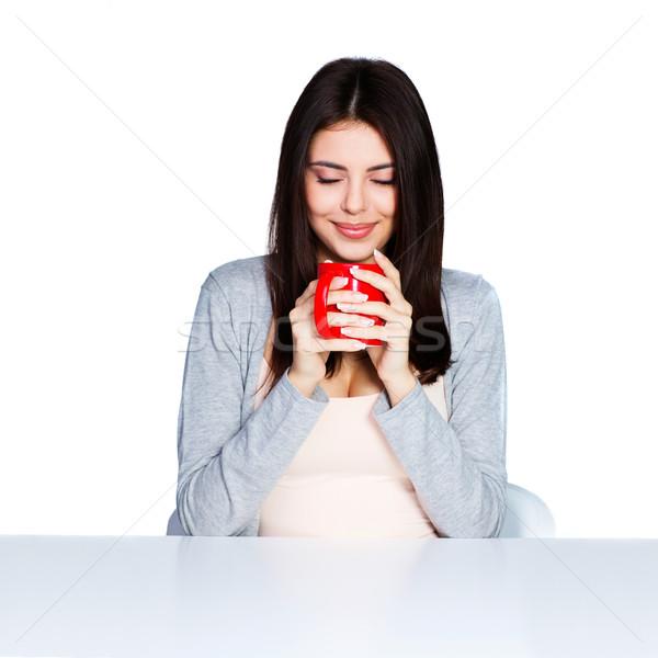 Belle jeune femme tasse favori Photo stock © deandrobot