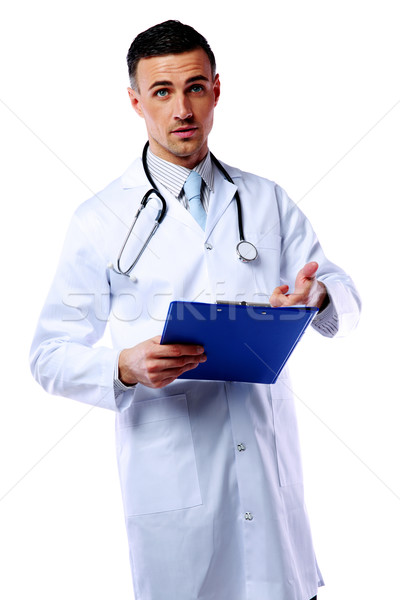 Male doctor telling diagnosis and showing on clipboard over white background Stock photo © deandrobot