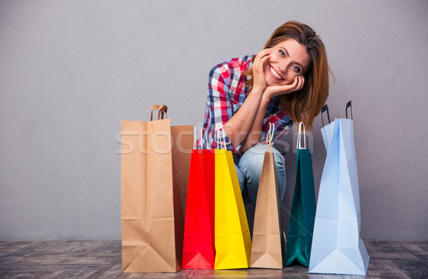 Woman with shopping bags Stock photo © deandrobot