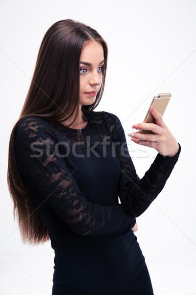 Kadın siyah elbise yalıtılmış beyaz Stok fotoğraf © deandrobot