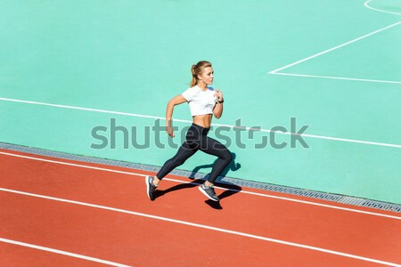 Female jogger running at stadium  Stock photo © deandrobot