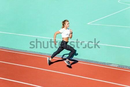 Kadın jogging yapan çalışma stadyum genç kadın Stok fotoğraf © deandrobot
