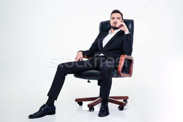 Stock photo: Assured confident business man with beard sitting in office chair