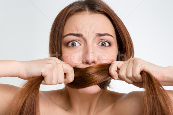 Scared frightened young woman covered mouth with her long hair  Stock photo © deandrobot